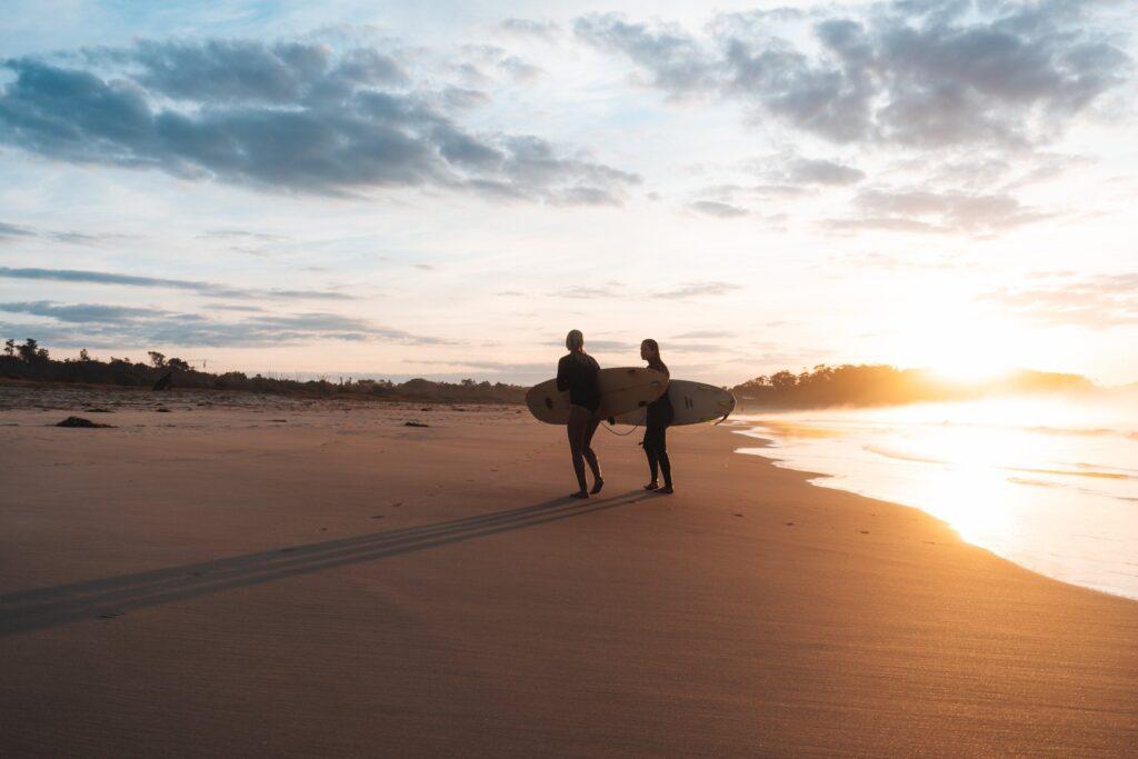2 surfers at Bengelo Beach at sunrise
